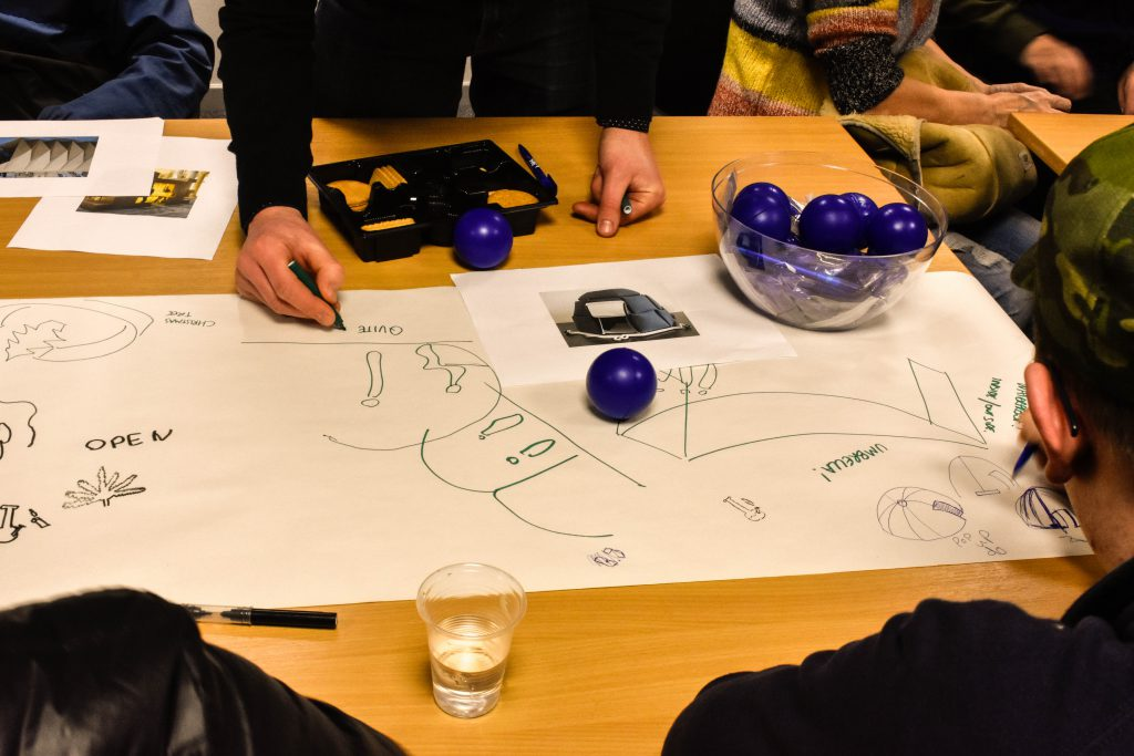 Group of architects and young people designing a safe space